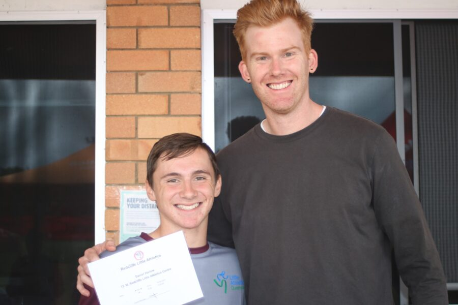 Reddy LA Pres David Austin presenting Daniel Harlow with this years 400m record certificate Last year Dan broke Davids 1998 400m record a record David held for 21 years